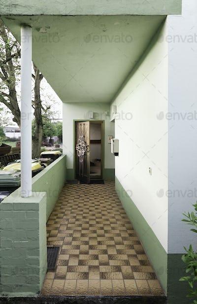 Patio walkway and doorway of retro home