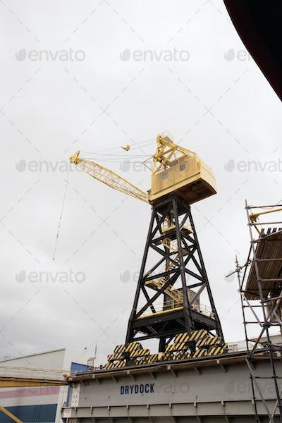 A crane at a dockyard for unloading cargo