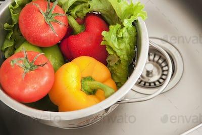 Vegetables in Colander, fresh washed in a sink