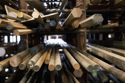 Wood Dowel Rods stacked on shelves