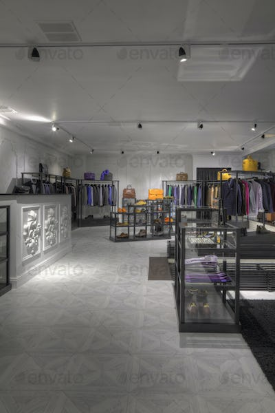 Suits and shoes in clothing store for men