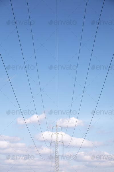 Low angle view of power lines under blue sky