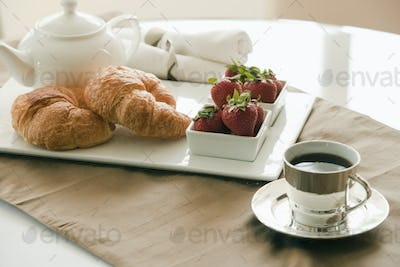 Breakfast Setting on Table, croissants and jam