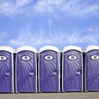 Row of Portable Plastic Toilets