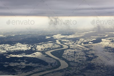 River Running through a Flooded Countryside