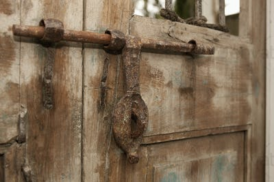 Old Iron Door Latch on Wooden Door
