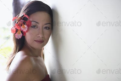 Woman posing with flower in her hair