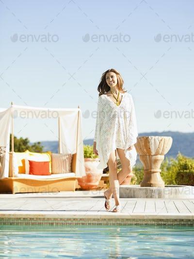 Caucasian woman standing near swimming pool