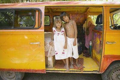 Children posing for the camera inside van