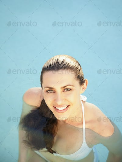 Close up overhead view of woman with wet hair in water at a luxury resort in California