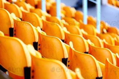 yellow plastic seats at stadium