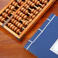 chinese book and abacus