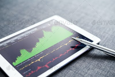Stock market graph on tablet pc