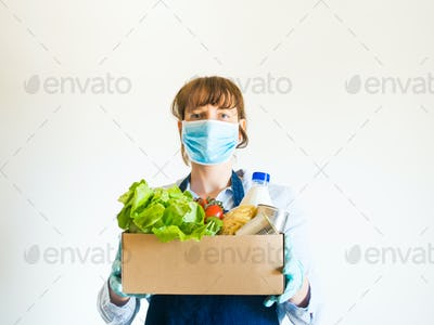 Woman in blue in face mask with food delivery box
