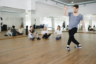 Group of young modern dancers dancing in the studio