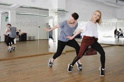 Young modern dancers dancing in the studio