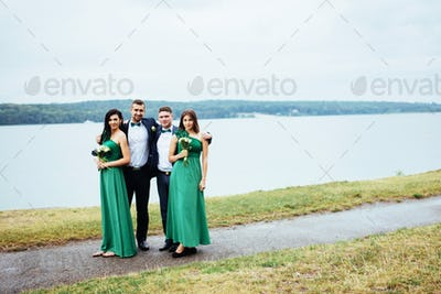 Portrait of a beautiful young drivers and bridesmaids. Wedding