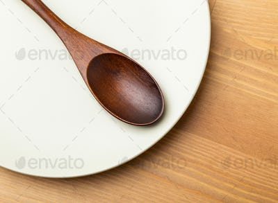 Vintage spoon on the white plate