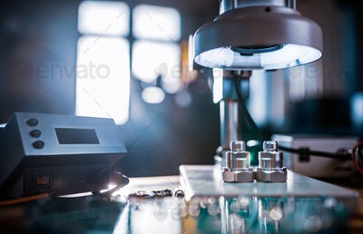 Modern microscope, connectors component and large green microcircuit in workshop laboratory