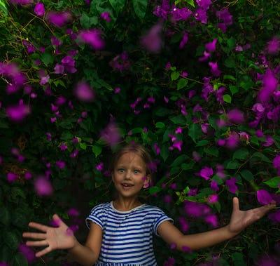 Little Girl Among Beautiful Flowers