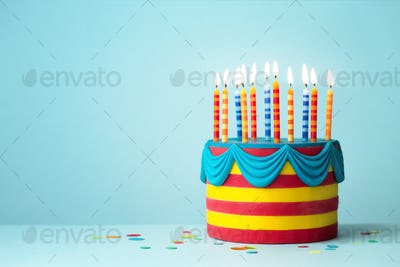 Brightly colored birthday cake with candles