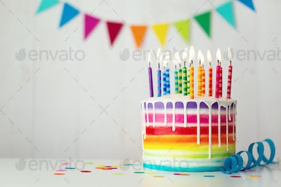 Rainbow birthday cake with candles