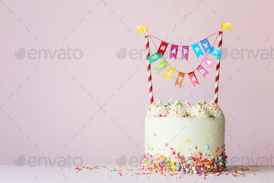 Birthday cake with colorful happy birthday banner
