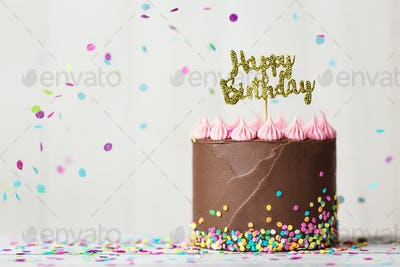 Chocolate birthday cake with happy birthday banner