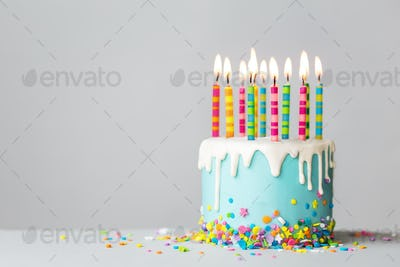 Birthday cake with drip icing and colorful candles