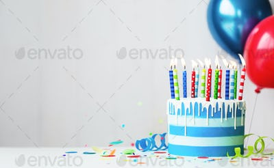 Colorful birthday cake with candles and balloons