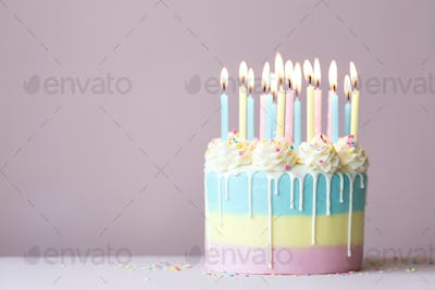 Pastel birthday cake with birthday candles