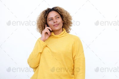 african american girl with curly hair talking on mobile and thinking phone by white background