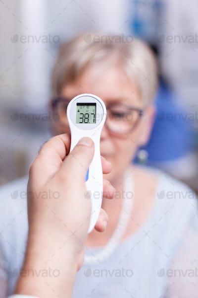 Senior patient having high temperature