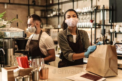 Coffee shop owners with face masks, lockdown
