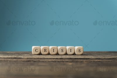 Word Crisis spelled on wooden dices