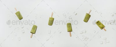 Flat-lay of homemade green matcha coconut popsicles