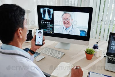 Doctor video calling colleagues