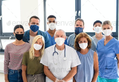 Portrait of doctor and people with face masks, coronavirus, covid-19 and vaccination concept