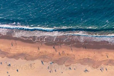 Aerial looking down view of people enjoying the beach in California
