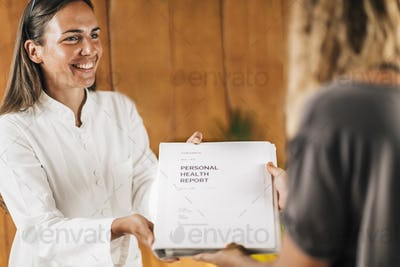 Functional Medicine Practitioner Giving Personal Health Report to the Patient