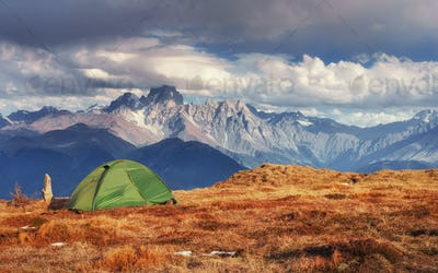 Tent green spread out on the pass Goulet. Georgia, Svaneti
