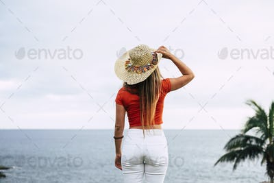 Beautiful unrecognizable young woman viewed from back