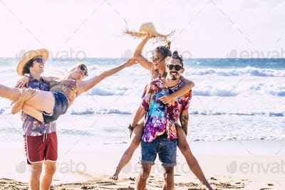 Happy group of caucasian young people at the beach