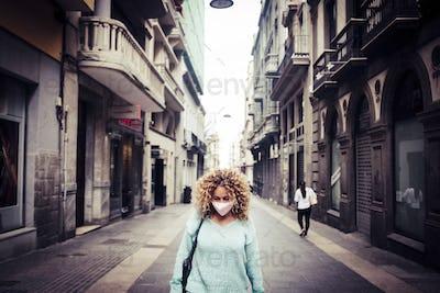 Sad woman standin coronavirus emergency city