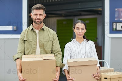 Portrait of Modern Couple Moving Boxes