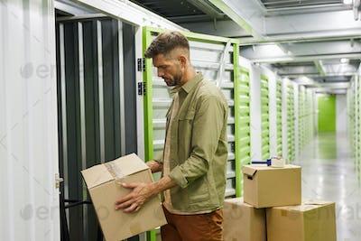 Man Loading Storage Unit