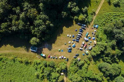 Aerial view of a camp with tents in the outdoors