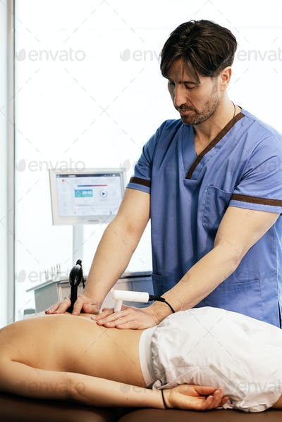 Physiotherapist giving backstroke therapy to a woman