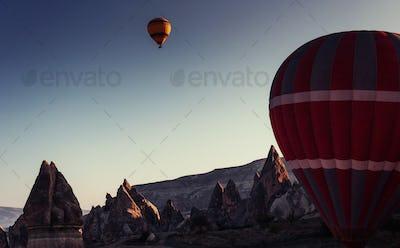 Amazing sunset over Cappadocia. Beautiful color balloons. Turkey