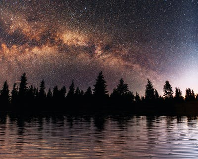 Starry sky over the sea. Fantastic Milky Way. Meteor shower